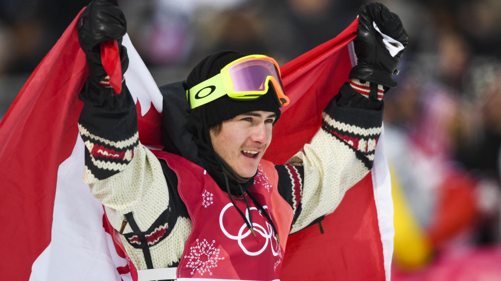 Canada's Sebastien Toutant celebrates winning gold in the final of the men's snowboard big air event at the Alpensia Ski Jumping Centre during the Pyeongchang 2018 Winter Olympic Games on February 24, 2018 in Pyeongchang.  / AFP PHOTO / FRANCK FIFE